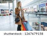 girl looks at something in her... | Shutterstock . vector #1267679158