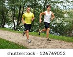 Two Young Athletes Jogging  ...