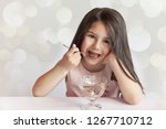 happy child girl eating ice... | Shutterstock . vector #1267710712