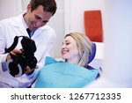 dentist checks taking photo of... | Shutterstock . vector #1267712335