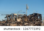 charred and blackened remains... | Shutterstock . vector #1267772392