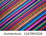wooven wool multicolor andean... | Shutterstock . vector #1267894528