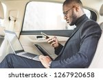 man in a business suit write on ... | Shutterstock . vector #1267920658