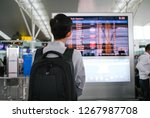 a man with backpacker looking... | Shutterstock . vector #1267987708