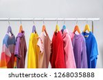 colorful clothes hanging on... | Shutterstock . vector #1268035888