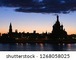 silhouette of the city on the... | Shutterstock . vector #1268058025