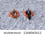 two people are floating on the...   Shutterstock . vector #1268065612
