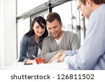 young couple buying new home.... | Shutterstock . vector #126811502