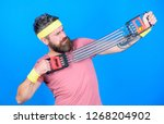 man bearded exercising with... | Shutterstock . vector #1268204902
