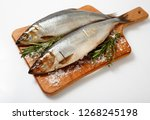 Stock photo herring fresh fish on a wooden board 1268245198