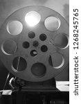 vintage movie projector. film... | Shutterstock . vector #1268245765