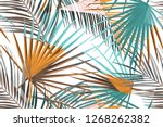 seamless tropical palm leaves... | Shutterstock . vector #1268262382