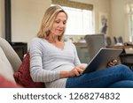 beautiful mature woman sitting... | Shutterstock . vector #1268274832