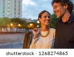 cheerful mature woman carring... | Shutterstock . vector #1268274865