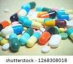 capsule pills and pill type... | Shutterstock . vector #1268308018