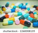 capsule pills and pill type... | Shutterstock . vector #1268308135