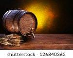 Old Oak Barrel On A Wooden...