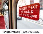 red emergency exit door sign on ... | Shutterstock . vector #1268423332