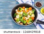 pan with frozen vegetable mix...   Shutterstock . vector #1268429818