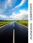 an empty asphalt road through...   Shutterstock . vector #1268453455