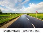 an empty asphalt road through...   Shutterstock . vector #1268453458