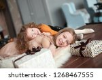 two pretty sisters lying on the ... | Shutterstock . vector #1268467555
