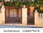 automatic gates. gate for a... | Shutterstock . vector #1268479678