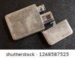 gasoline lighter at dark wooden ...   Shutterstock . vector #1268587525
