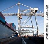 gantry crane unloading a... | Shutterstock . vector #126862235