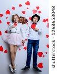 happy pre teen boy and girl ... | Shutterstock . vector #1268653048