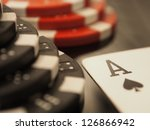 ace of spades and poker chips   Shutterstock . vector #126866942