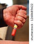 injecting emergency medicine....   Shutterstock . vector #1268685622