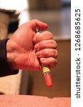injecting emergency medicine....   Shutterstock . vector #1268685625