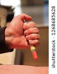 injecting emergency medicine....   Shutterstock . vector #1268685628