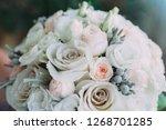 beautiful wedding bouquet of... | Shutterstock . vector #1268701285