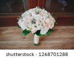 beautiful wedding bouquet of... | Shutterstock . vector #1268701288