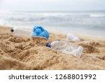 Plastic Trash At The Sandy...