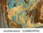 gold marbling texture design.... | Shutterstock . vector #1268824942