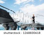 confident engineer in helmet... | Shutterstock . vector #1268830618