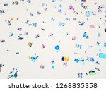 a vibrant aerial view of people ... | Shutterstock . vector #1268835358