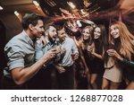 smiling girl. vocal battle....   Shutterstock . vector #1268877028