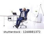 young businessman sitting in... | Shutterstock . vector #1268881372