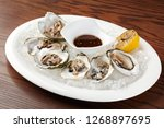 oysters with lemon and dill on... | Shutterstock . vector #1268897695