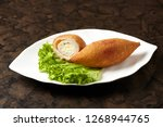 chicken kiev  breaded chicken... | Shutterstock . vector #1268944765