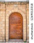 old wooden door. entrance to... | Shutterstock . vector #1269013318