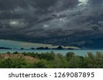 dramatic stormy cloud sky above ... | Shutterstock . vector #1269087895