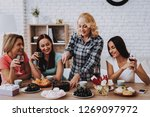 lady cut cake for friends....   Shutterstock . vector #1269097972