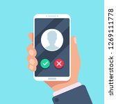 incoming call on mobile phone.... | Shutterstock . vector #1269111778