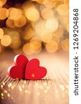 red heart shaped on a wooden... | Shutterstock . vector #1269204868