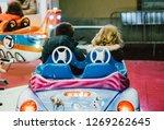 Children Enjoying Riding On A...